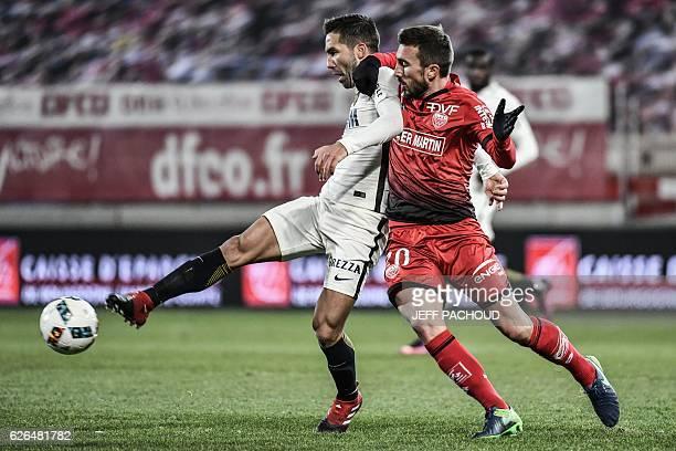 Dijon's French midfielder Romain Amalfitano vies with Monaco's Portuguese midfielder Joao Moutinho during the French L1 football match Dijon vs...