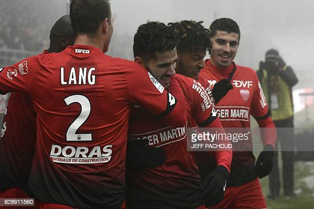 Dijon's FrenchAlgerian midfielder Mehdi Abeid celebrates with teammates after scoring a goal during the French L1 football match Dijon vs Marseille...