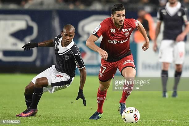 Dijon's FrenchAlgerian midfielder Mehdi Abeid challenges Bordeaux's Uruguayan forward Diego Rolan during the French L1 football match between...