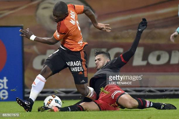 Dijon's FrenchAlgerian midfielder Mehdi Abeid vies with Lorient's Ghanaian forward Abdul Waris Majeed during the French L1 football match between...