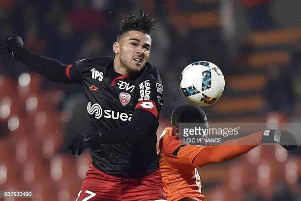 Dijon's FrenchAlgerian midfielder Mehdi Abeid vies with Lorient's French midfielder Makengo Arnold Mvuemba during the French L1 football match...