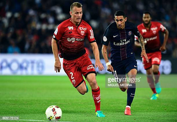 Dijon's Hungarian defender Adam Lang vies for the ball with Paris SaintGermain's Argentinian forward Angel Di Maria during the French L1 football...