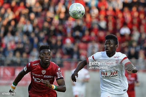 Dijon's Ivorian defender Abdoulaye Bamba vies with Nancy's French midfielder Abdou Coulibaly during the French L2 football match Dijon vs Nancy on...