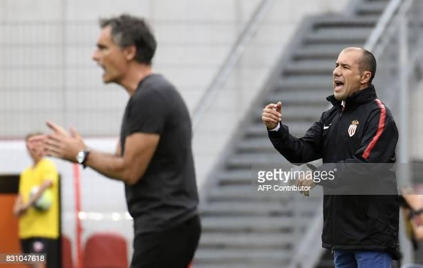 Dijon's main coach Olivier DallOglio and Monaco's Portuguese coach Leonardo Jardim give their instructions during the French L1 football match...