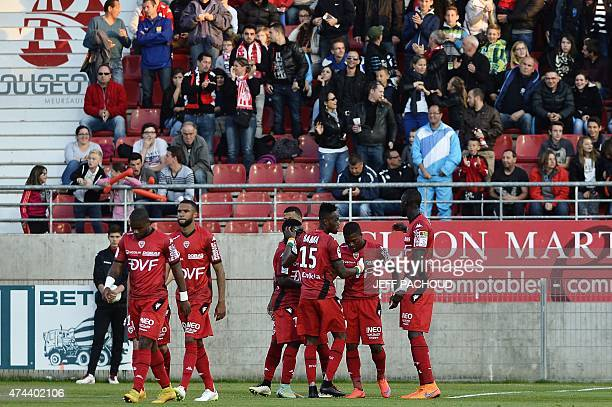 Dijon's players celebrate after Dijon's French midfielder Jeremy Bela scored a goal during the French L2 football match Dijon vs Nancy on May 22 at...