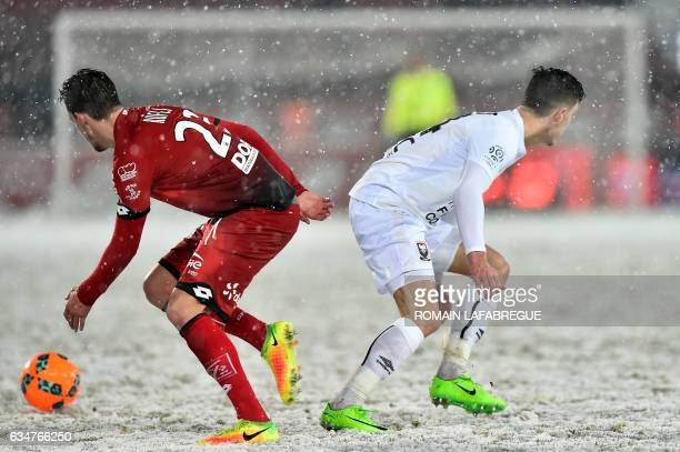 TOPSHOT Dijon's Swiss defender Vincent Rufli vies with Caen's French defender Frederic Guilbert during the French L1 football match between Dijon and...