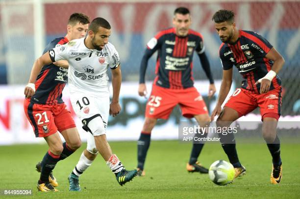 Dijon's Tunisian midfielder Naim Sliti vies for the ball with Caen's FrenchMoroccan midfielder Youssef Ait Bennasser during the French L1 football...