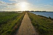 Dike Path  with Sun