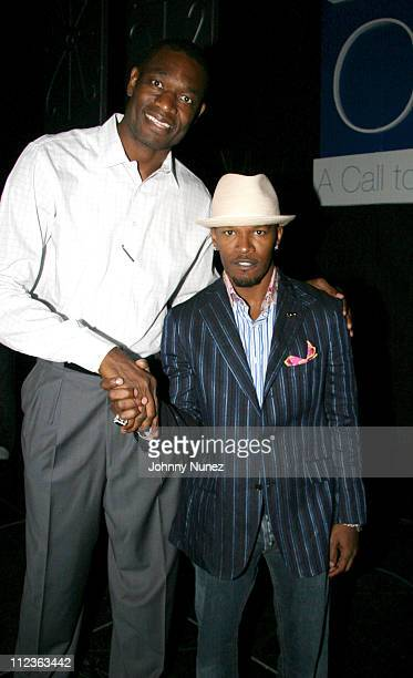 Dikembe Mutombo and Jamie Foxx during Coca Cola Presents the 2006 Essence Music Festival Day 2 at Reliant Park in Houston Texas United States