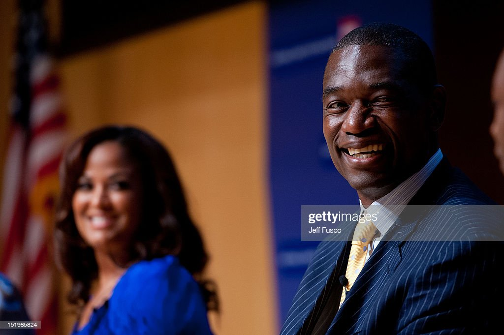 Dikembe Mutombo (R) and Laila Ali take part in a panel discussion prior to the 2012 Liberty Medal Ceremony at the National Constitution Center on September 13, 2012 in Philadelphia, Pennsylvania.
