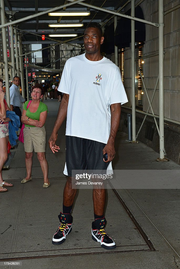 Dikembe Mutombo arrives to the Ritz-Carlton on July 12, 2013 in New York City.
