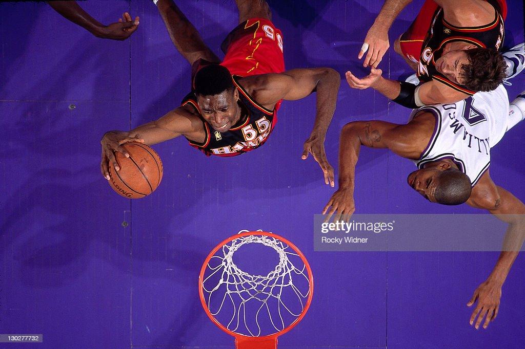 Dikembe Mutombo of the Atlanta Hawks shoots against Corliss Williamson of the Sacramento Kings on November 7 1996 at Arco Arena in Sacramento...