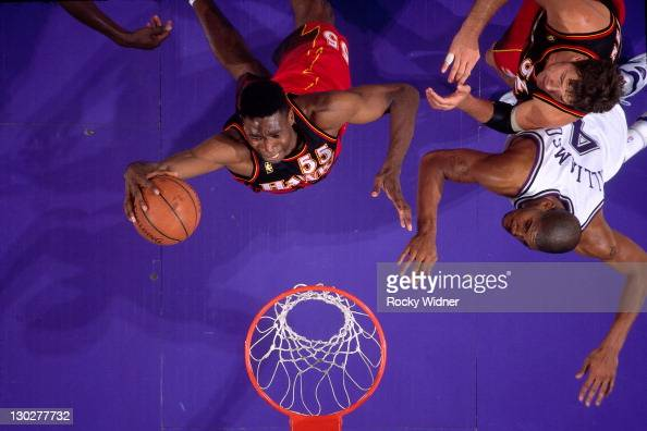 Dikembe Mutombo of the Atlanta Hawks shoots against Corliss Williamson of the Sacramento Kings on November 7 1996 at Arco Arena in Sacramento...