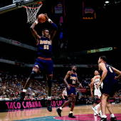 Dikembe Mutombo of the Denver Nuggets grabs a rebound against the San Antonio Spurs during an NBA game at the Alamo dome on January 28 1995 in San...