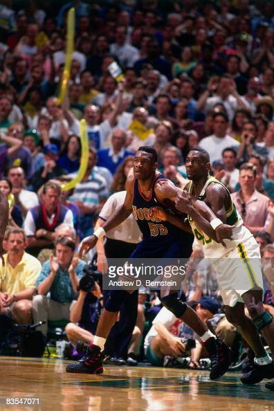 Dikembe Mutombo of the Denver Nuggets posts up against Shawn Kemp of the Seattle Supersonics during Game Five of the Western Conference Quarterfinals...