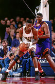 Dikembe Mutombo of the Denver Nuggets posts up against the Denver Nuggets circa 1994 at the McNichols Sports Arena in Denver Colorado NOTE TO USER...