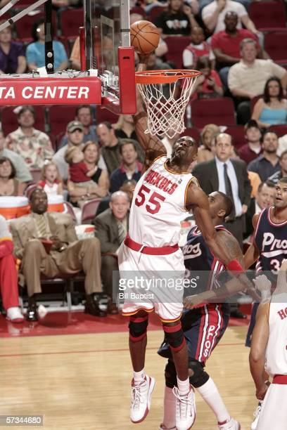 Dikembe Mutombo of the Houston Rockets flies in for the dunk in front of Lorenzen Wright of the Memphis Grizzlies on April 15 2006 at the Toyota...