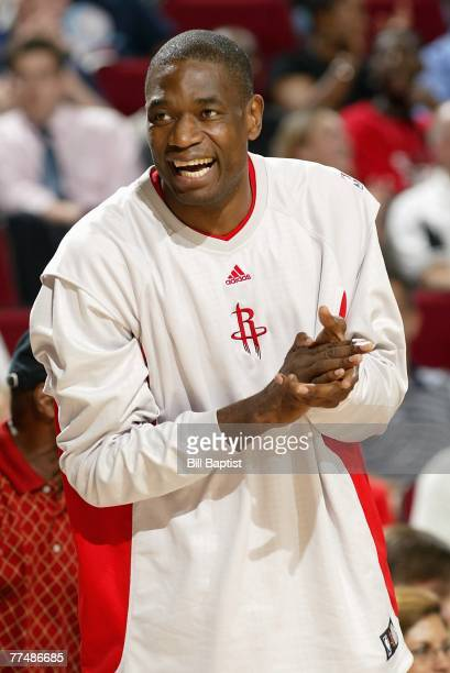 Dikembe Mutombo of the Houston Rockets reacts to a play during the game against the Dallas Mavericks at the Toyota Center on October 18 2007 in...