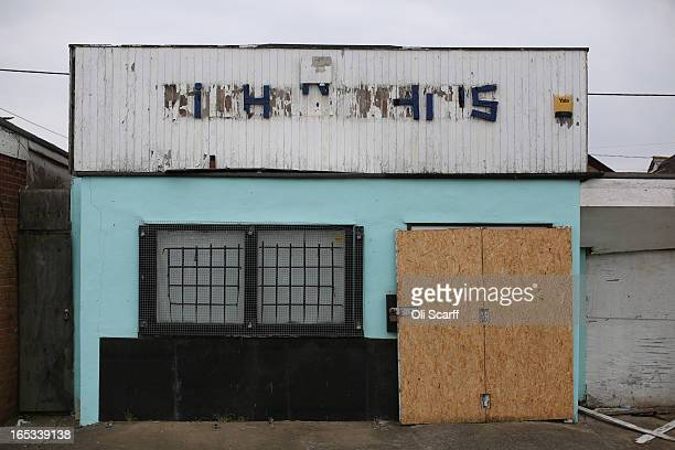 A dilapidated and boardedup shop stands in the seaside town of East Jaywick the most deprived place in England on April 3 2013 in Jaywick England The...