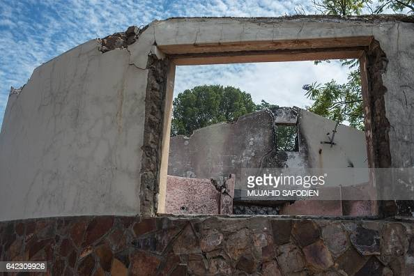TOPSHOT A dilapidated building is pictured on February 13 2017 in the desert town of Pomfret close to the Botswana border on the edge of the Kalahari...