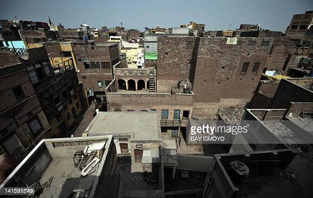 Dilapidated buildings and residences are pictured in the old town section of Multan on March 17 2012 Multan one of the oldest cities in the Asian...