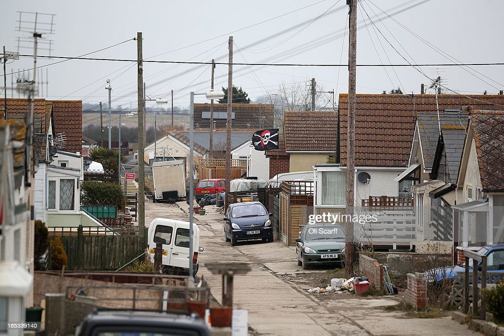 Dilapidated properties stand in the seaside town of East Jaywick, the most deprived place in England, on April 3, 2013 in Jaywick, England. The Government's 2011 Indices of Multiple Deprivation' measure ranks Jaywick as the most deprived of all 32,482 small wards in England and Wales. The area also has the greatest number of young people not in employment, education or training; one third of 16 to 24 year-olds claim Jobseeker's Allowance, compared to the national average of 6 per cent. Changes to the benefits and tax system which came into force on April 1, 2013 have included a cut in housing benefit payments for working-age social housing tenants whose property is deemed larger than they need and council tax support payments now being administered locally.