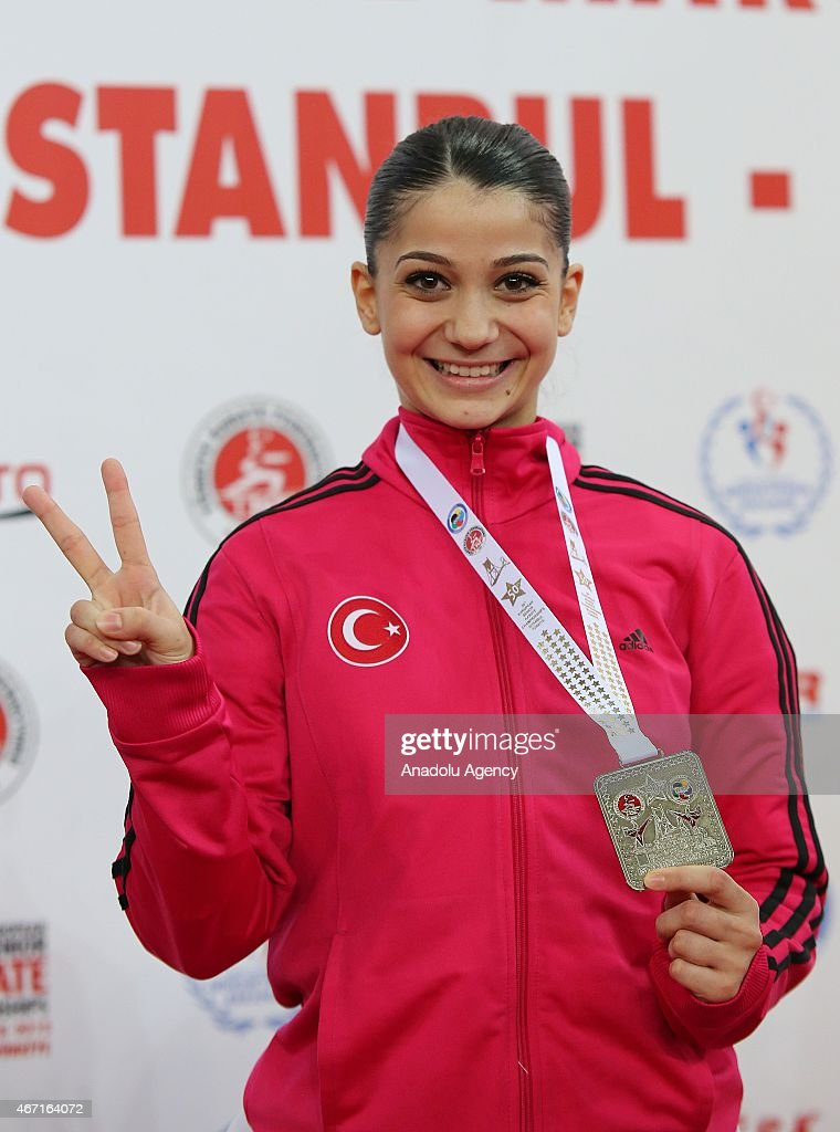 Dilara Bozan of Turkey poses after winning the silver medal during women's final match of Kata within 50th European Seniors Karate Championship at Sinan Erdem Sport Hall in Istanbul, Turkey on March 21, 2015.