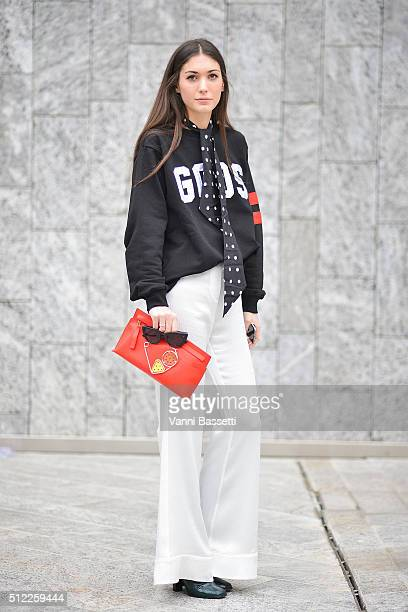 Diletta Bonaiuti poses wearing a GCDS sweatshirt and Loewe clutch before the Costume National show during the Milan Fashion Week Fall/Winter 2016/17...