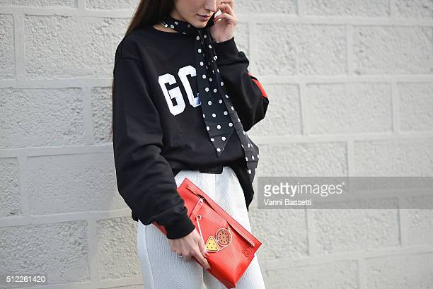 Diletta Bonaiuti poses wering a GCDS sweatshirt and Loewe bag before the Emilio Pucci show during the Milan Fashion Week Fall/Winter 2016/17 on...