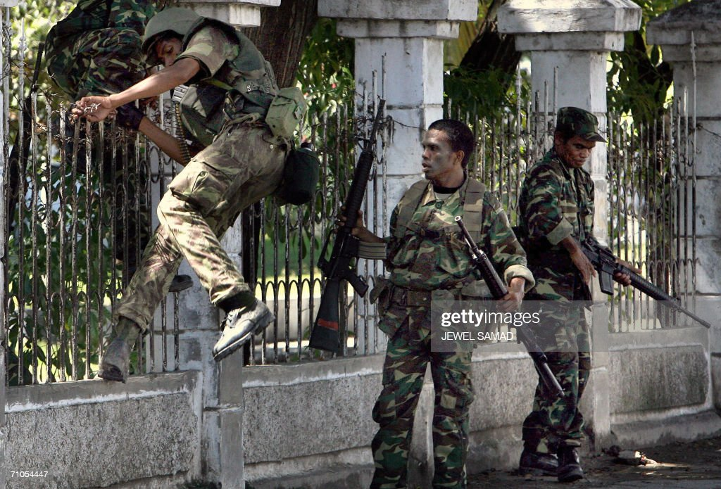 East Timorese government forces soldiers leave their position to go back to their barracks in Dili 26 May 2006 East Timor handed over security to...