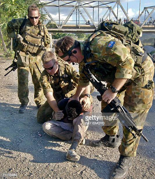 Members of the Australian peacekeeping force detain a man during clashes involving gangs in Dili 03 June 2006 East Timor's underfire prime minister...