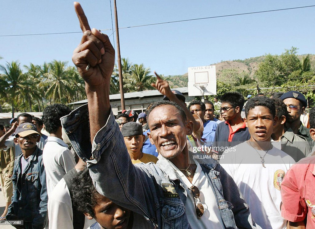 People protest outside the venue where East Timorese leaders were holding meeting in Dili 29 May 2006 East Timor's divided government held crisis...