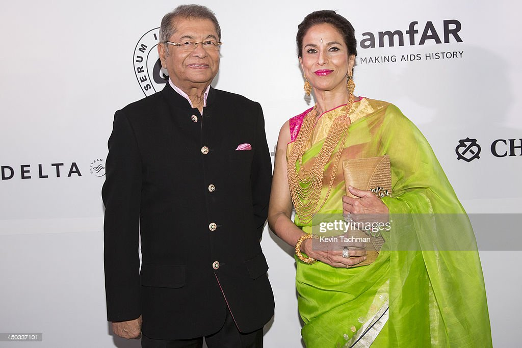 Dilip De and Shobha De attend the inaugural amfAR India event at the Taj Mahal Palace Mumbai on November 17, 2013 in Mumbai, India.
