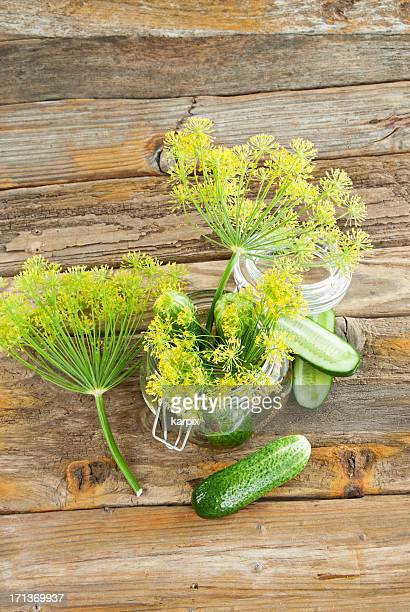 Dill Pickles on wooden worktop