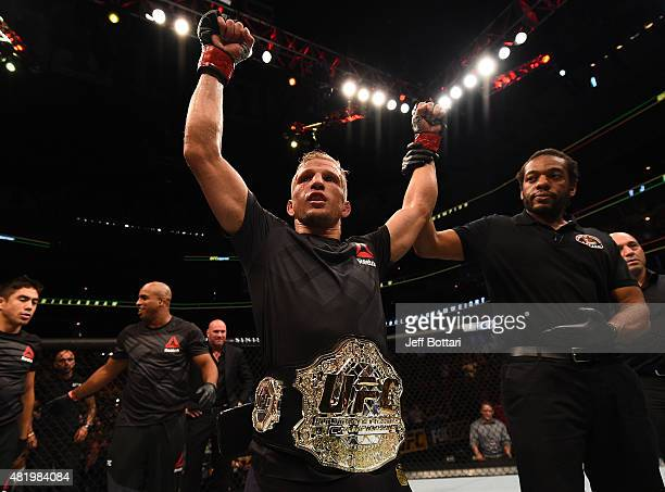 Dillashaw celebrates after his TKO victory over Renan Barao of Brazil in their UFC bantamweight championship bout during the UFC event at the United...