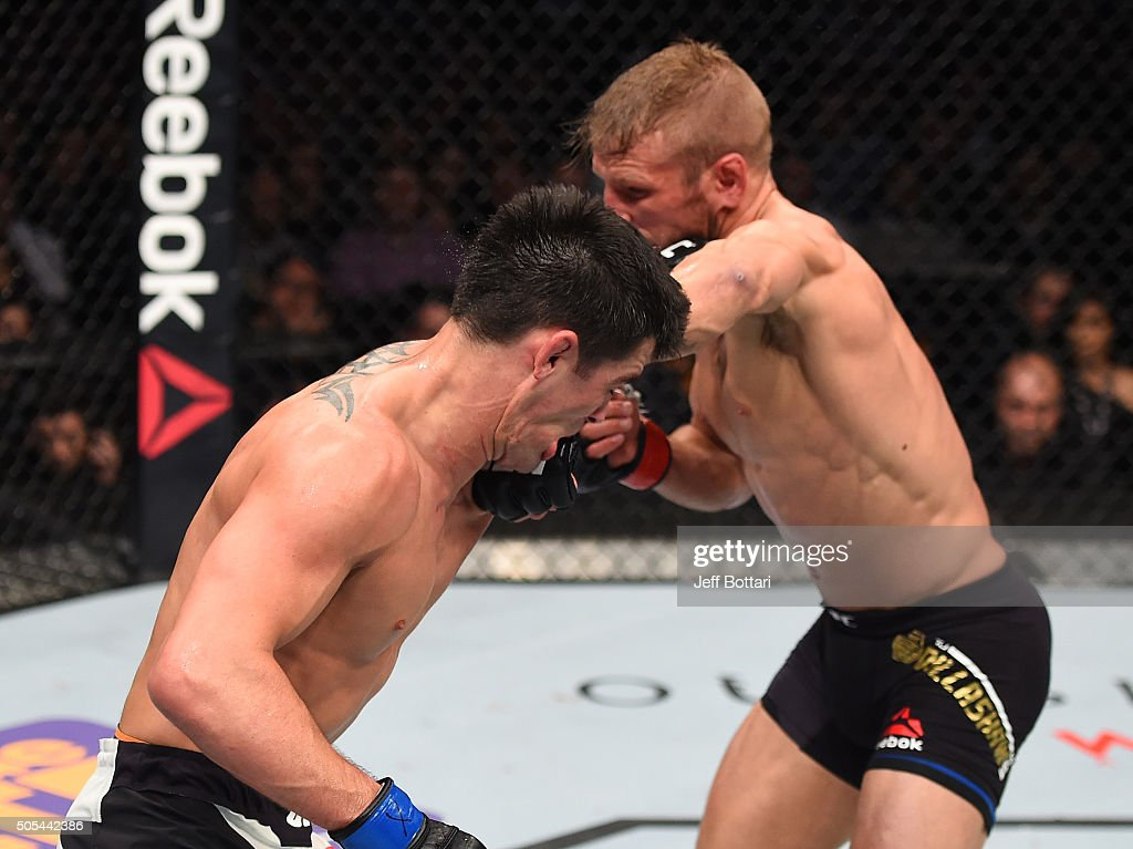 TJ Dillashaw punches Dominick Cruz in their UFC bantamweight championship bout during the UFC Fight Night event inside TD Garden on January 17, 2016 in Boston, Massachusetts.