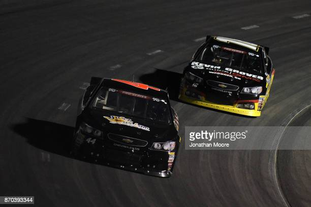 Dillon Bassett driver of the Bassett Gutters and More Toyota and Bill Kann driver of the Kevin Grover GMC Toyota race on track during the NASCAR KN...
