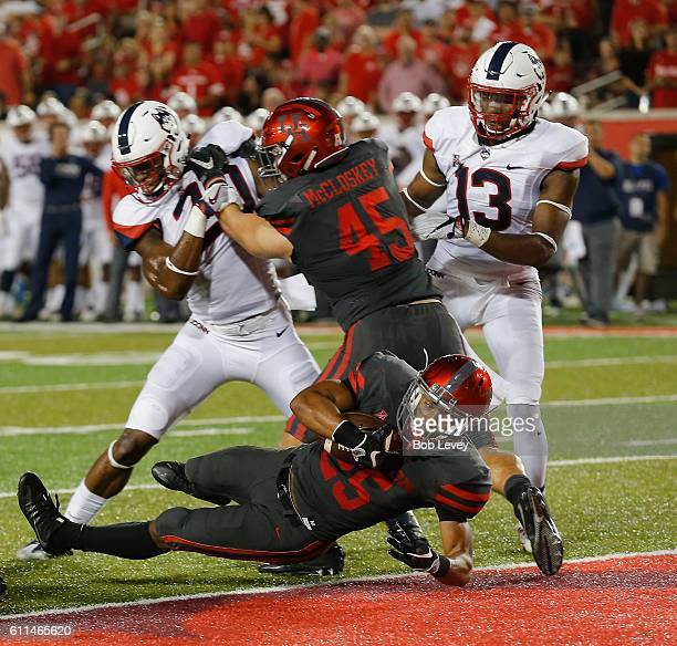 Dillon Birden of the Houston Cougars scores as he gets a block from Tyler McCloskey on Obi Melifonwu of the Connecticut Huskies on September 29 2016...