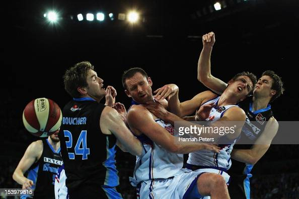 Dillon Boucher and Tom Abercrombie of the Breakers compete with Anthony Petrie and Daniel Johnson of Adelaide and during the round two NBL match...