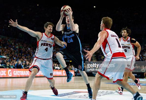Dillon Boucher of the Breakers drives to the basket as Greg Hire of the Wildcats defends during game one of the NBL Grand Final series between the...