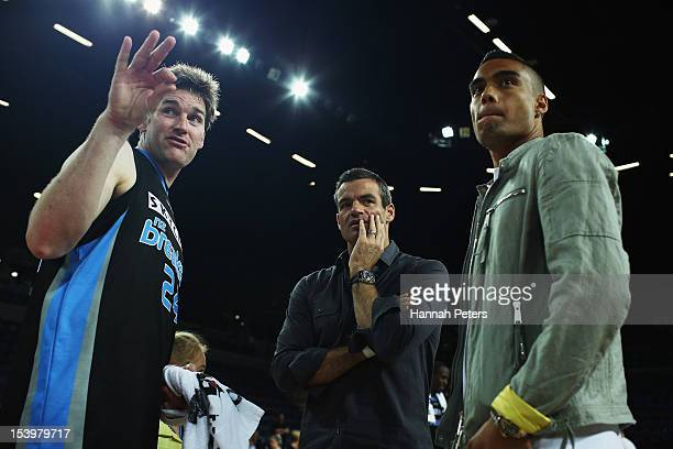 Dillon Boucher of the Breakers meets with All Whites Winston Reid and Ryan Nelsen following the round two NBL match between the New Zealand Breakers...