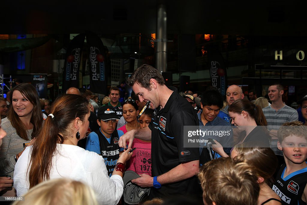 Dillon Boucher of the New Zealand Breakers signs autographs during a homecoming celebration after winning the 2012/13 NBL Championship at Sky City on...
