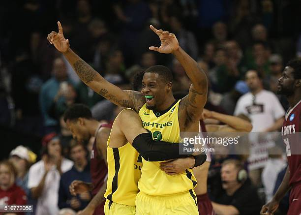 Dillon Brooks and Elgin Cook of the Oregon Ducks celebrate their 6964 win over the Saint Joseph's Hawks during the second round of the 2016 NCAA...