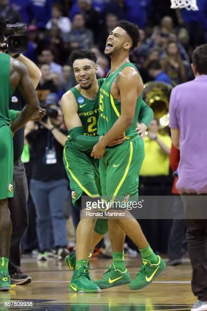 Dillon Brooks and Tyler Dorsey of the Oregon Ducks celebrate defeating the Kansas Jayhawks 7460 during the 2017 NCAA Men's Basketball Tournament...