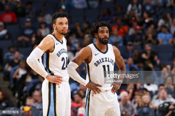 Dillon Brooks of the Memphis Grizzlies and Mike Conley of the Memphis Grizzlies look on during a preseason game against the New Orleans Pelicans on...