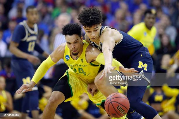 Dillon Brooks of the Oregon Ducks and DJ Wilson of the Michigan Wolverines battle for the ball in the second half during the 2017 NCAA Men's...