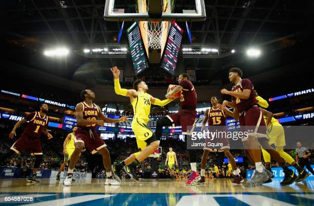 Dillon Brooks of the Oregon Ducks and Taylor Bessick of the Iona Gaels battle for the ball in the first half during the first round of the 2017 NCAA...