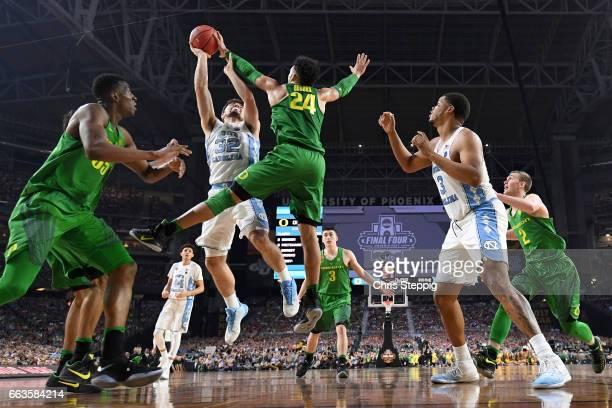 Dillon Brooks of the Oregon Ducks blocks Luke Maye of the North Carolina Tar Heels during the 2017 NCAA Men's Final Four Semifinal at University of...