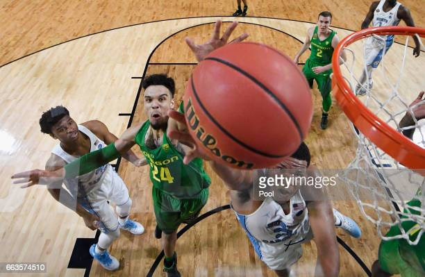 Dillon Brooks of the Oregon Ducks defends Kennedy Meeks of the North Carolina Tar Heels during the 2017 NCAA Men's Final Four Semifinal at University...