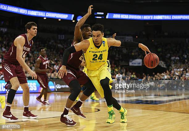 Dillon Brooks of the Oregon Ducks drives against James Demery of the Saint Joseph's Hawks in the second half during the second round of the 2016 NCAA...